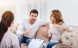 Emotional cheerless couple having a disagreement Stock Photo