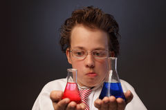 Emotional chemist with two flasks Royalty Free Stock Photography