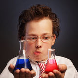 Emotional chemist with two flasks Royalty Free Stock Images