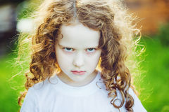 Emotional child with angry expression on face. stock images