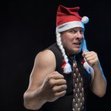Emotional Comic actor man in cap with braids gesticulates, in anticipation of Christmas and New Year Royalty Free Stock Image