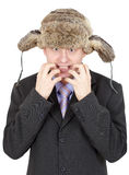 Emotional comical Russian man in fur hat Royalty Free Stock Images