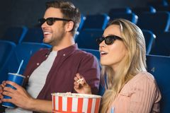 emotional couple in 3d glasses with popcorn and soda drink watching film together stock photo