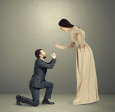 Emotional couple over grey background Royalty Free Stock Photography