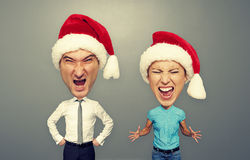 Emotional couple in santa hat over dark Stock Images