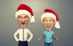 Emotional couple in santa hat over dark. Emotional bighead couple in santa hat over dark background stock illustration