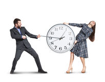 Emotional couple stretching out the clock Royalty Free Stock Photos