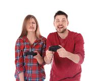 Emotional couple with video game controllers. On white background Stock Images