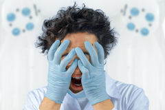 Emotional crazy doctor Stock Images