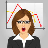 Emotional crying businesswoman in economic crisis with line graph showing negative trend Stock Photo