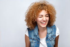 Emotional curly hair girl in casual style. royalty free stock images