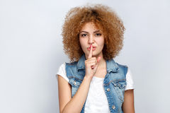 Emotional curly hair girl in casual style. Stock Photo