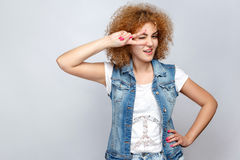 Emotional curly hair girl in casual style. Stock Photos