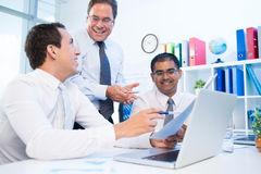 Emotional discussion. Image of business partners having emotional discussing at the office Stock Photos