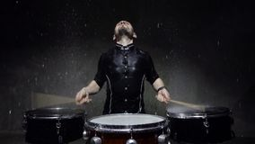 Emotional drummer plays in water studio. 240fps slow motion stock video