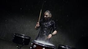 Emotional drummer plays in water studio. 240fps slow motion stock footage
