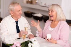 Emotional elderly lady excited about proposal Royalty Free Stock Photo