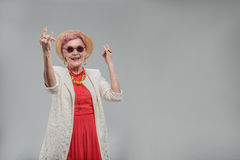 Emotional elderly woman gesturing positively Stock Photography