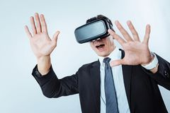 Emotional entrepreneur playing VR games over background royalty free stock photos