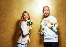 Emotional fashion couple give each other flowers on Valentine`s. Day. Vogue style Royalty Free Stock Image