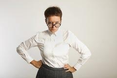 Emotional female teacher in glasses royalty free stock image
