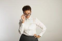 Emotional female teacher in glasses royalty free stock photo