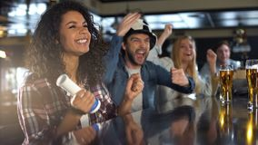 Emotional football fans celebrating national team winning game, successful game. Stock photo stock photos