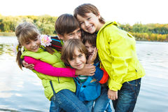 Emotional friends. Group of emotional friends playing in autumn park Royalty Free Stock Photography