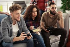 Emotional friends playing video games royalty free stock image