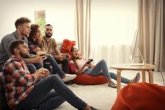 Emotional friends playing video games royalty free stock photography