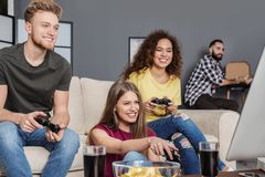 Emotional friends playing video games royalty free stock photo