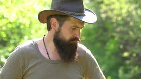 Emotional funny bearded hipster on the farm. Eco farm. Retro farmer man. handsome bearded farmer working with spud on stock video