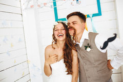 Emotional Funny Moment of Wedding. Day. Beautiful Loving Couple Having Fun. Selective Focus. Wedding Props royalty free stock photo
