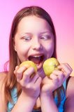 Emotional funny teen girl eating apple Royalty Free Stock Photo