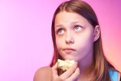 Emotional funny teen girl eating apple Stock Photography