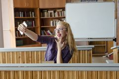 Emotional girl blonde with mobile Stock Photography