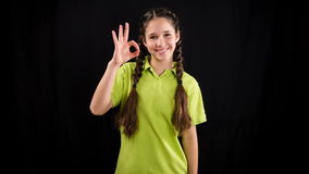 Emotional girl in green clothes, stop motion animation stock video footage