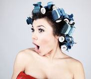 Emotional Girl with hair-curlers on her head Stock Image