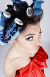 Emotional Girl with hair-curlers on her head Royalty Free Stock Photography