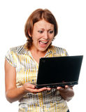 Emotional girl with laptop Royalty Free Stock Photography