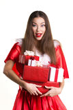 Emotional girl with presents Royalty Free Stock Images