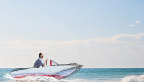Emotional girl riding boat . Mixed media Stock Photography