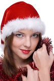 Emotional girl in santa clause dress Royalty Free Stock Images