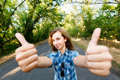 Emotional girl shows  finger up, sign ok Stock Photography