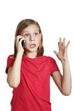 Emotional girl talking on the phone royalty free stock photography