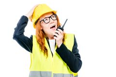 Emotional girlfriend foreman with a walkie-talkie Royalty Free Stock Photography