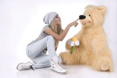 Emotional, glamour girl with a toy Stock Images