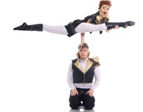 Emotional go-go performers doing acrobatic trick Stock Image