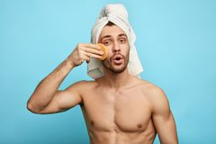 Emotional gorgeous man using a pad royalty free stock photography
