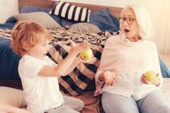 Emotional granny getting surprised after watching her grandson talent Royalty Free Stock Photography